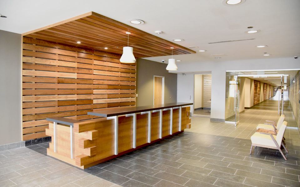 Corporate welcome desk featuring lots of wooden beam work