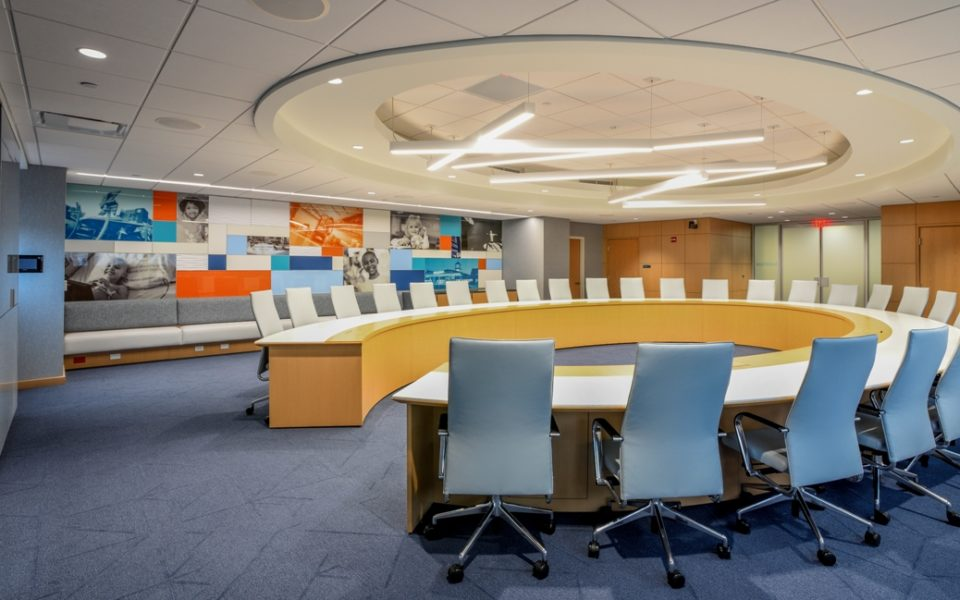 Conference room with large, curved, U-shaped table in the center