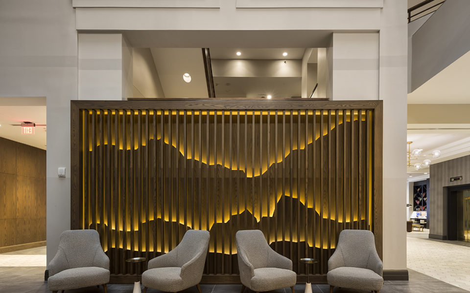 An artistic feature wall handcrafted from wood in a hotel lobby