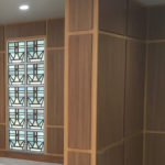 Wood panel walls with stained glass
