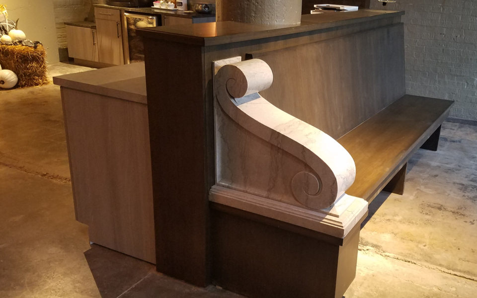 Crane Factory Flats Interior wooden bench with stone scrollwork
