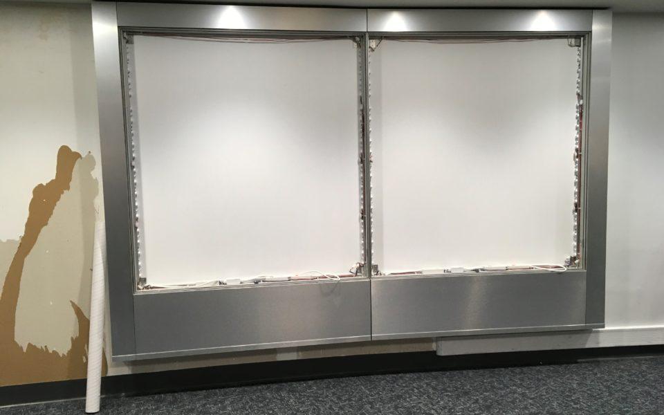 large frame display with metal surrounding