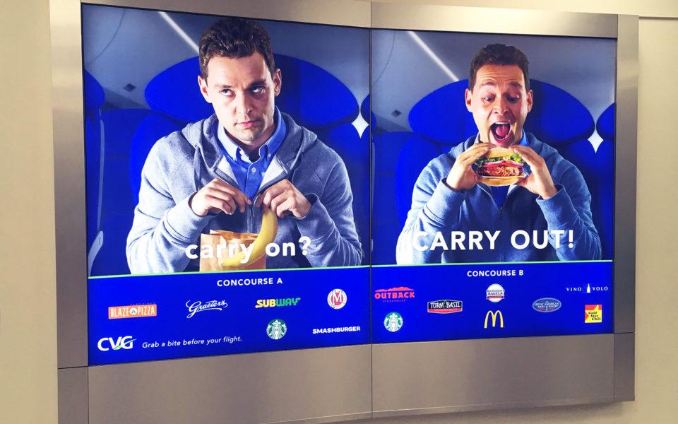 Departure Media ad displays at CVG airport