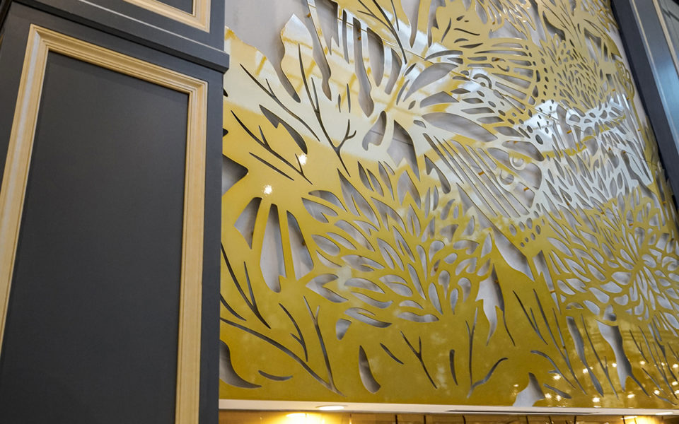 detail of casework and laser cut decor